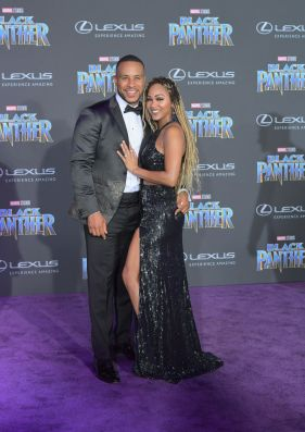 LOS ANGELES, CA - JANUARY 29: DeVon Franklin (L) and Meagan Good arrive for the World Premiere of Marvel Studios' Black Panther, presented by Lexus, at Dolby Theatre in Hollywood on January 29th. (Photo by Charley Gallay/Getty Images for Lexus )